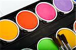 Water-color box with paint brushes on white background Stock Photo - Royalty-Free, Artist: mphoto                        , Code: 400-05063406