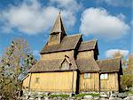 Urnes stave church (Urnes stavkirke) is located near Lustrafjorden in Luster municipality, Norway. It is believed to be the oldest stave church and it is listed as a world heritage site by UNESCO.