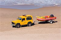 Rescue vehicle towing a rescue rubber dinghy on the beach Stock Photo - Royalty-Freenull, Code: 400-05068637