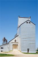 A large grain elevator shot against a blue sky Stock Photo - Royalty-Freenull, Code: 400-05070882