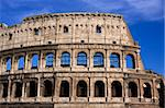 Antique colosseum in Rome over blue sky