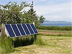 A set of solar panels located on an island provide a source of renewable energy. Stock Photo - Royalty-Free, Artist: searagen                      , Code: 400-05081506