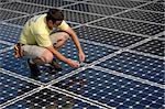 a technician works on the installation of a solar panel Stock Photo - Royalty-Free, Artist: keithpix                      , Code: 400-05081717