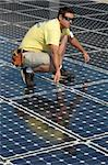 a technician works on the installation of a solar panel Stock Photo - Royalty-Free, Artist: keithpix                      , Code: 400-05081718