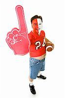 fat man balls - Overweight, middle aged sports fan in a football jersey with a number one foam finger. Stock Photo - Royalty-Freenull, Code: 400-05082209