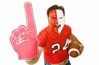 fat man balls - Football fan shouting and waving a Number One foam finger.  Isolated on white. Stock Photo - Royalty-Freenull, Code: 400-05082215