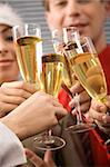 Image of businesspeople hands holding crystal glasses full of champagne Stock Photo - Royalty-Free, Artist: pressmaster                   , Code: 400-05082846
