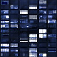 Voyeuring Office Building After Dark In Blue Tones Stock Photo - Royalty-Freenull, Code: 400-05084823