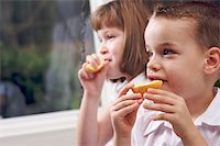 pre-teen boy models - Sister and Brother Having Fun Eating an Apple Stock Photo - Royalty-Freenull, Code: 400-05086667