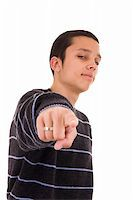 Young man pointing at you isolated on white   Stock Photo - Royalty-Freenull, Code: 400-05089195