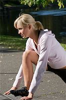 cute and young woman in sport wear making gym exercise in park Stock Photo - Royalty-Freenull, Code: 400-05109129