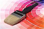 A paint brush over a wheel of colorful paint swatches. Stock Photo - Royalty-Free, Artist: Laures                        , Code: 400-05111190