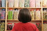young girl looking at rows of sweets in shop Stock Photo - Royalty-Free, Artist: gemphotography                , Code: 400-05117207