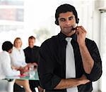 Young Businessman on a headset Stock Photo - Royalty-Free, Artist: 4774344sean                   , Code: 400-05129752