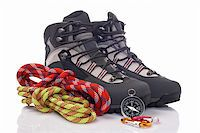 Hiking boots, two rope and compass reflected on white background Stock Photo - Royalty-Freenull, Code: 400-05133946