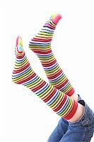 woman legs in strip sock on white background Stock Photo - Royalty-Freenull, Code: 400-05134191
