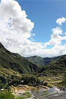 philippine terrace farming - clouds towering in blue sky reflected in the ancient rice terraces of batad, in northern luzon, the philippines Stock Photo - Royalty-Freenull, Code: 400-05134648