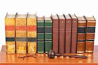 Wooden gavel from the court and old law books reflected on white background. Shallow depth of file Stock Photo - Royalty-Freenull, Code: 400-05134977