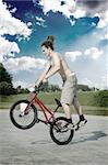 Extreme bicycle rider performing freestyle tricks on his bike.