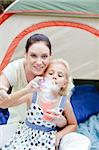 Young mother and daughter playing in tent Stock Photo - Royalty-Free, Artist: 4774344sean                   , Code: 400-05137243