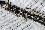 Fragment of black shining clarinet over opened music book Stock Photo - Royalty-Free, Artist: simply                        , Code: 400-05138078