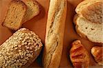 Varied bread styles still over warm clay background Stock Photo - Royalty-Free, Artist: lunamarina                    , Code: 400-05161899