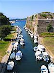 Kerkyra harbour. Fishing boats in canal outside old fortress