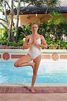 Woman doing Yoga by Pool Stock Photo - Premium Royalty-Freenull, Code: 600-05181870