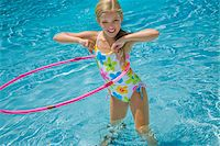 Girl in Pool with Hula Hoop Stock Photo - Premium Royalty-Freenull, Code: 600-05181875