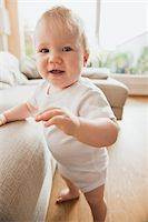 Baby Girl Standing by Sofa Stock Photo - Premium Royalty-Freenull, Code: 600-05181885