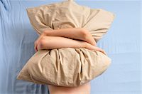 Boy Hugging Pillow in Bed Stock Photo - Premium Rights-Managednull, Code: 700-05181853