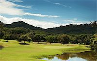 Image of a beautiful golf course fairway at a tropical resort Stock Photo - Royalty-Freenull, Code: 400-05187616