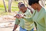 Happy African American Man, Woman and Child Having Fun in the Park. Stock Photo - Royalty-Free, Artist: Feverpitched                  , Code: 400-05190189