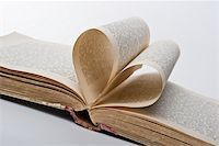 Pages of an old book folded in to a heart shape Stock Photo - Royalty-Freenull, Code: 400-05192703