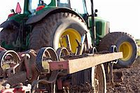 plow - Close up of plow on a tractor in a field in spring Stock Photo - Royalty-Freenull, Code: 400-05196473