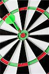 Green dart punctured in the center of the target Stock Photo - Royalty-Free, Artist: Gelpi                         , Code: 400-05198514