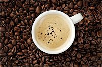 Image of a Cappuccino on coffee beans Stock Photo - Royalty-Freenull, Code: 400-05199874