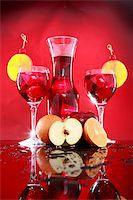 Wedged with an orange slice and maraschino cherry Stock Photo - Royalty-Freenull, Code: 400-05202436