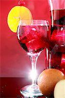 Wedged with an orange slice and maraschino cherry Stock Photo - Royalty-Freenull, Code: 400-05202439