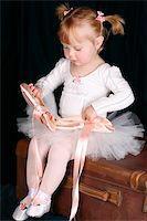 Little ballet toddler wearing a white tutu  Stock Photo - Royalty-Freenull, Code: 400-05210410