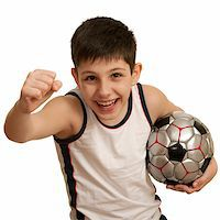 A running teen holding his right fist up and with a football ball in his left hand; isolated on the white background Stock Photo - Royalty-Freenull, Code: 400-05211448