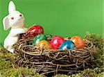 An Easter nest fully with nicely brightly painted eggs with an Easter hare. Stock Photo - Royalty-Free, Artist: toberl77                      , Code: 400-05212023