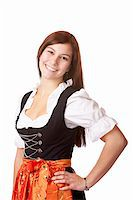 Portrait of young beautiful Bavarian woman in Oktoberfest Dirndl cloth. Isolated on white background. Stock Photo - Royalty-Freenull, Code: 400-05230930