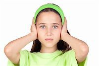 Frightened girl with ears plugged isolated on a white background Stock Photo - Royalty-Freenull, Code: 400-05238242