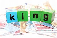 assorted childrens toy letter building blocks against a white background on money that spell king Stock Photo - Royalty-Freenull, Code: 400-05241320