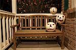 Three white jack o'lanterns on a wooden bench waiting for halloween Stock Photo - Royalty-Free, Artist: sgoodwin4813                  , Code: 400-05242209