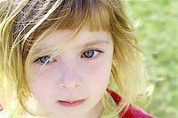 beautiful blond little girl children portrait outdoor in park Stock Photo - Royalty-Freenull, Code: 400-05248188