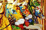 closeup of some horses of a vintage carousel