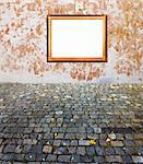 old russian style vintage golden frame on old time grunge background wall old stone blocks and maple leaves strong concept dissonance of elegant and brutal old things Stock Photo - Royalty-Free, Artist: mrVitkin                      , Code: 400-05265790