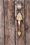 Brass handle and lock on an old wooden door vertical Stock Photo - Royalty-Free, Artist: sgoodwin4813                  , Code: 400-05266190